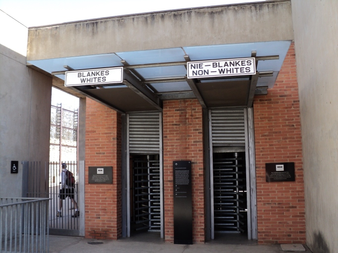 entrances for whites and non-whites to the apartheid museum